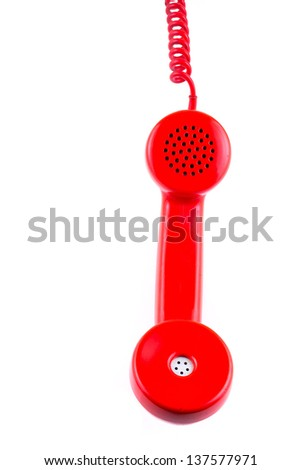 A red telephone receiver on white background
