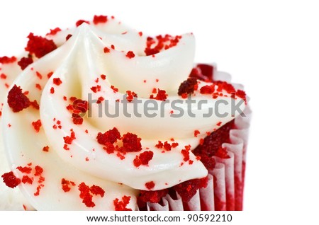 A Red Velvet Cupcake Closeup with Sprinkles