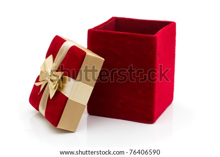 A red velvet present with a gold bow isolated on white, Happy Holidays