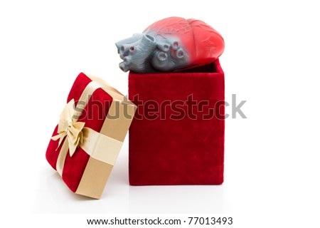 A red velvet present with model heart, Giving the gift of life - stock photo