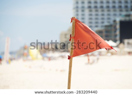 A red warning flag on the beautiful beaches of Cancun, Mexico