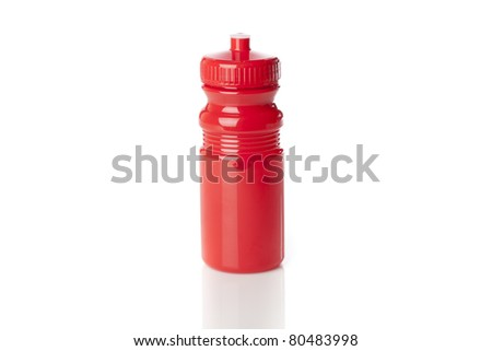A red water bottle against a white background