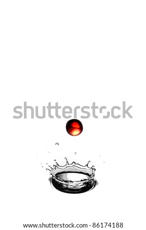 Stock Photo A red waterdrop falling into a splash - highspeed photography