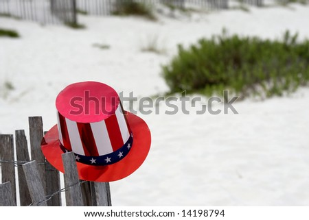 A red, white and blue hat on the beach in Gulf Shores Alabama.