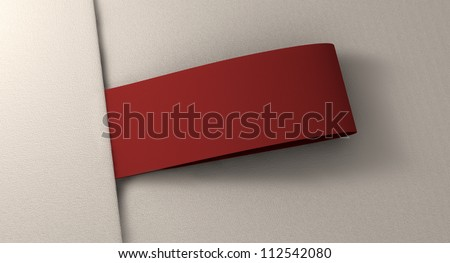 A red woven clothing label sewn into seamed white fabric