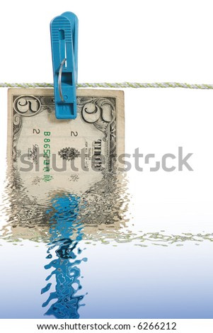 A reflect of five dollars banknote in water