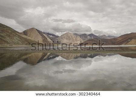 A reflecting view of Pangong Lake, Ladakh, India. #302340464