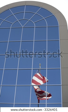 A reflection of an American flag in the windows