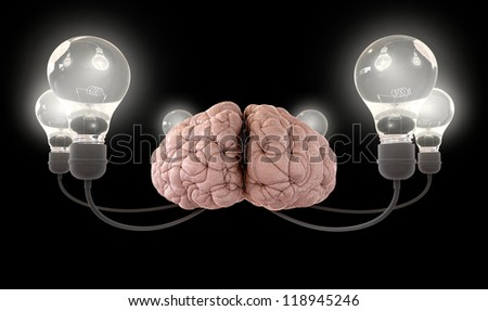 A regular brain encircled by six cords  attached to illuminated light bulbs on an isolated black background