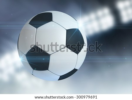 A regular soccer ball flying through the air on an indoor stadium background during the night