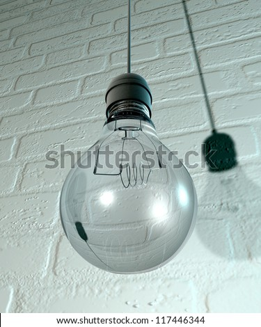 A regular unlit light bulb fitted into a light fitting hanging from a chord on a white washed brick wall