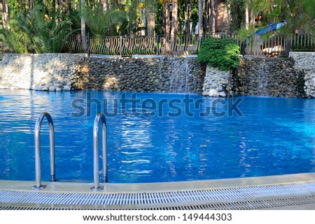 a relaxing open-air swimming pool in the garden