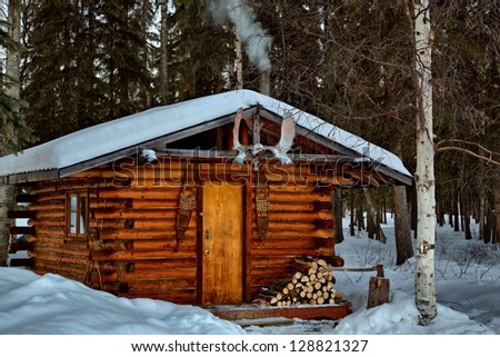 A remote log cabin during winter in Alaska's interior.