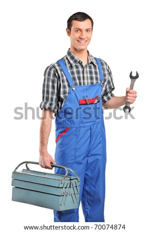 A repairman in blue overall holding a toolbox and wrench isolated on white background