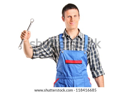 A repairman in overall holding a wrench and toolbox isolated on white background