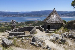 A replica of Celtic huts at the Castro archaeological site with ruins in Santa Tecla, Galicia, Spain