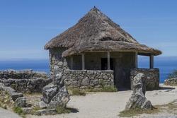 A replica of Celtic huts at the Castro culture archaeological site in Santa Tecla, Galicia, Spain