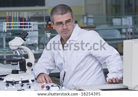 A researcher checking data on the computer computer at his workplace.