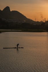 a resident there ciburuy fishing using a raft in the afternoon
