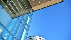 A residential building and an adjacent office building. Modern urban development.