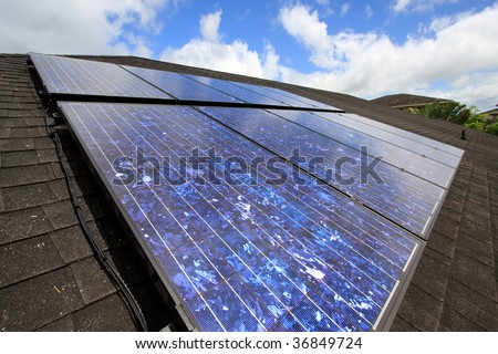 a residential mounted array of solar photovoltaic panels.