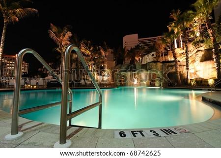 A resort swimming pool at night