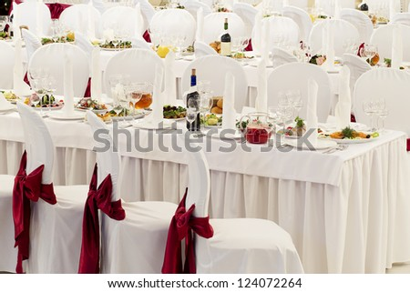 a restaurant banquet room decorated for a wedding party
