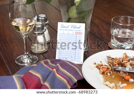 A restaurant dinnertime guest check left blank for placement of copy