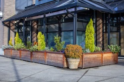 A restaurant storefront is closed during the Coronavirus (Covid-19) pandemic in North Vancouver's lower Lonsdale area, despite a large outdoor patio with garden planters