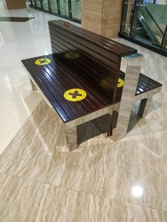 a resting bench in the shopping mall following social distancing rule