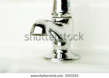 A retro bathroom sink tap detail.