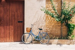 a retro bike is parked at house entrance