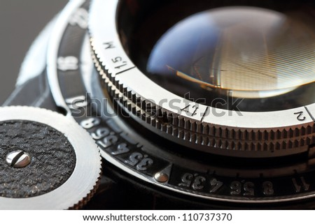 A retro camera lens close-up. Shallow DOF.