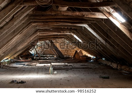 a retro dilapidated attic - stock photo