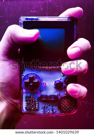 A retro handheld video game console with a old school purple vibe #1401029639