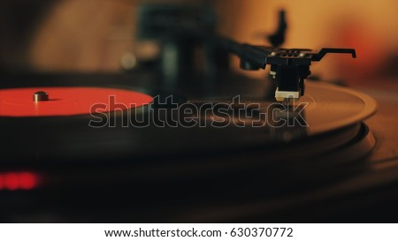 A retro-styled spinning record vinyl player. Close up. #630370772