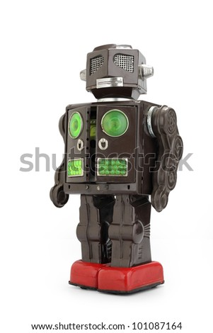 a  retro tin robot toy isolated on white background