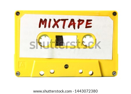 A retro vintage cassette tape (obsolete audio tech) with the handwritten text Mixtape (red marker, white label, electro yellow plastic body).  #1443072380