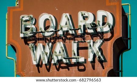 A Retro Vintage Rustic Neon Boardwalk Sign In California