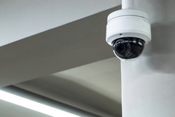A review of surveillance cameras on white background. Security concept. Facial recognition. Program search for criminals.