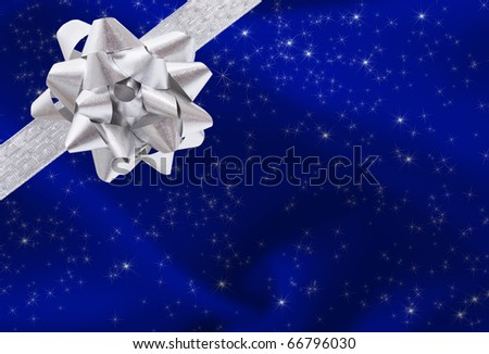 A ribbon and bow on a blue background, christmas present background