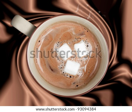A rich cup of hot chocolate against a silky brown background