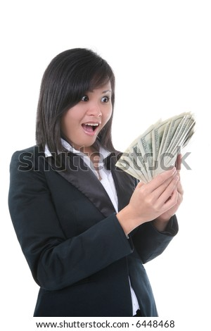 A rich young business woman with a lot of money - stock photo