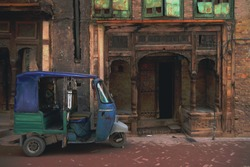 A rickshaw parked in front of an old historical building in the streets of Peshawar, Pakistan.