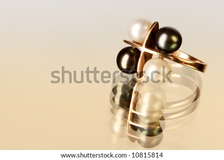 A ring with black and white pearls