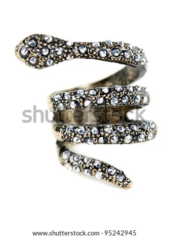 A ring with stones in the form of a snake on a white background