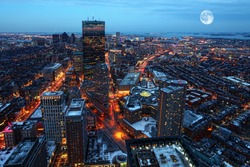 A Rising moon over the city of Boston