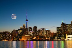A Rising moon over Toronto, Canada