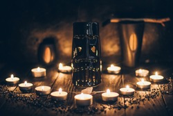 A ritual halloween witchcraft scene with candles, tiki statue on the rustic background
