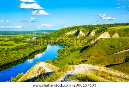 A river in a mountain valley. River valley landscape. Mountain river valley landscape ストックフォト ©